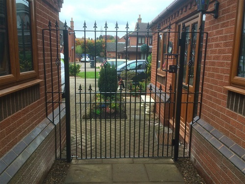 Extra wide bespoke metal gate with matching bespoke side panels