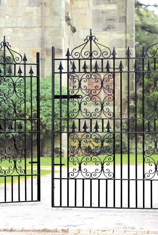 Decorative custom built gates in a bespoke style