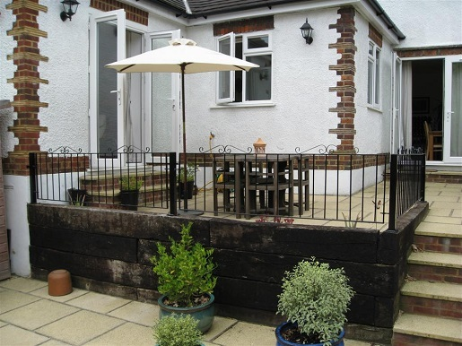 Metal garden railings fitted to raised terrace area