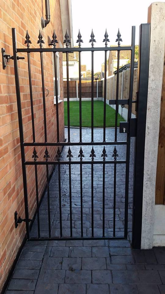 Corfe metal side gate in a made to measure size fitted to side entrance of garden