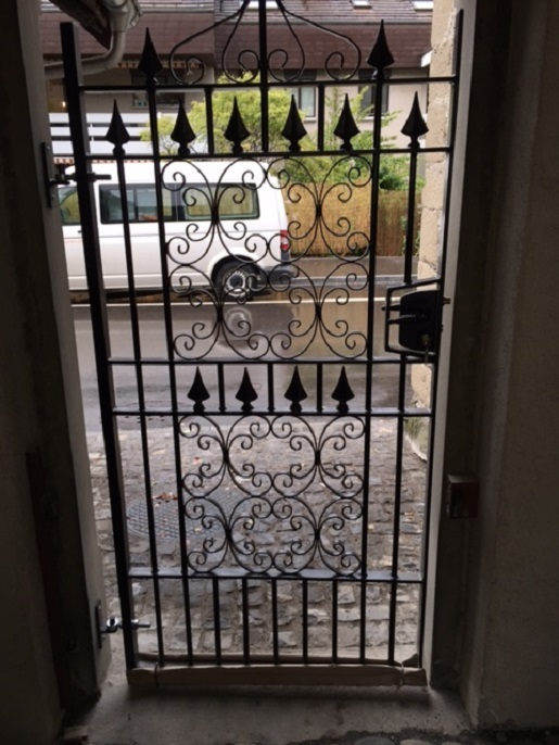 Decorative iron side gate with a heavy duty lock