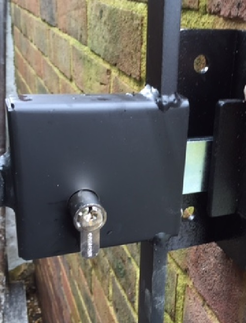A metal gate fitted with a key operated lock is secure and convenient to use