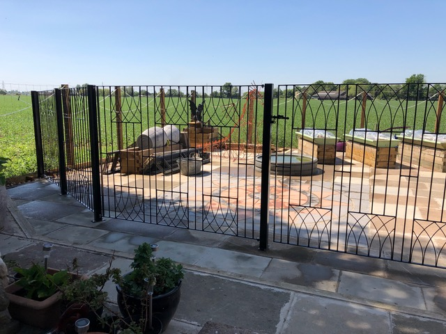 Bespoke abbey metal gate with additional fence panels