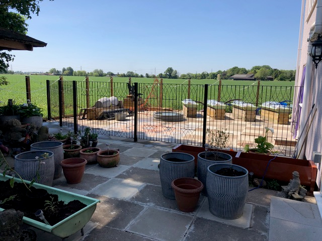 Abbey metal garden fencing and gate installed onto residential patio