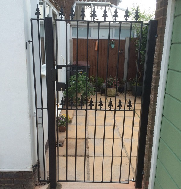 Residential side access gate with spear top finials