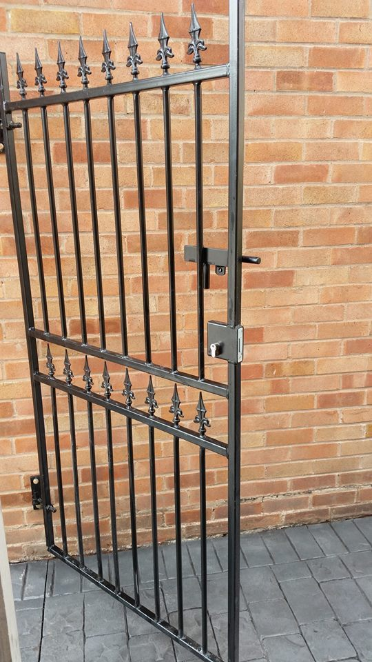 Corfe wrought iron style side gate with hinges mounted direct to brick walls