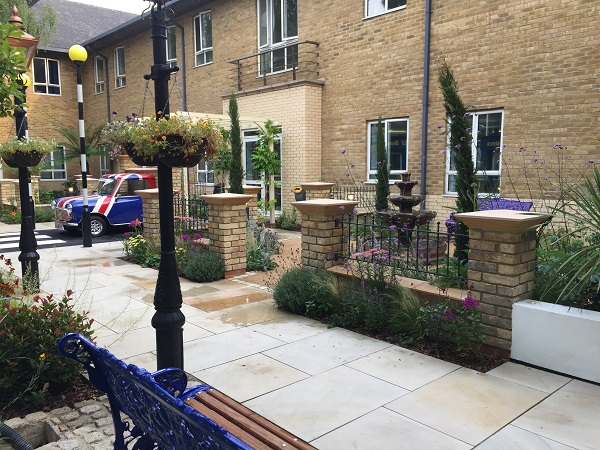 Metal garden railings with ball top finials fitted to brick walls