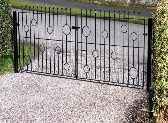 Picasso modern driveway gates fitted to residential parking area