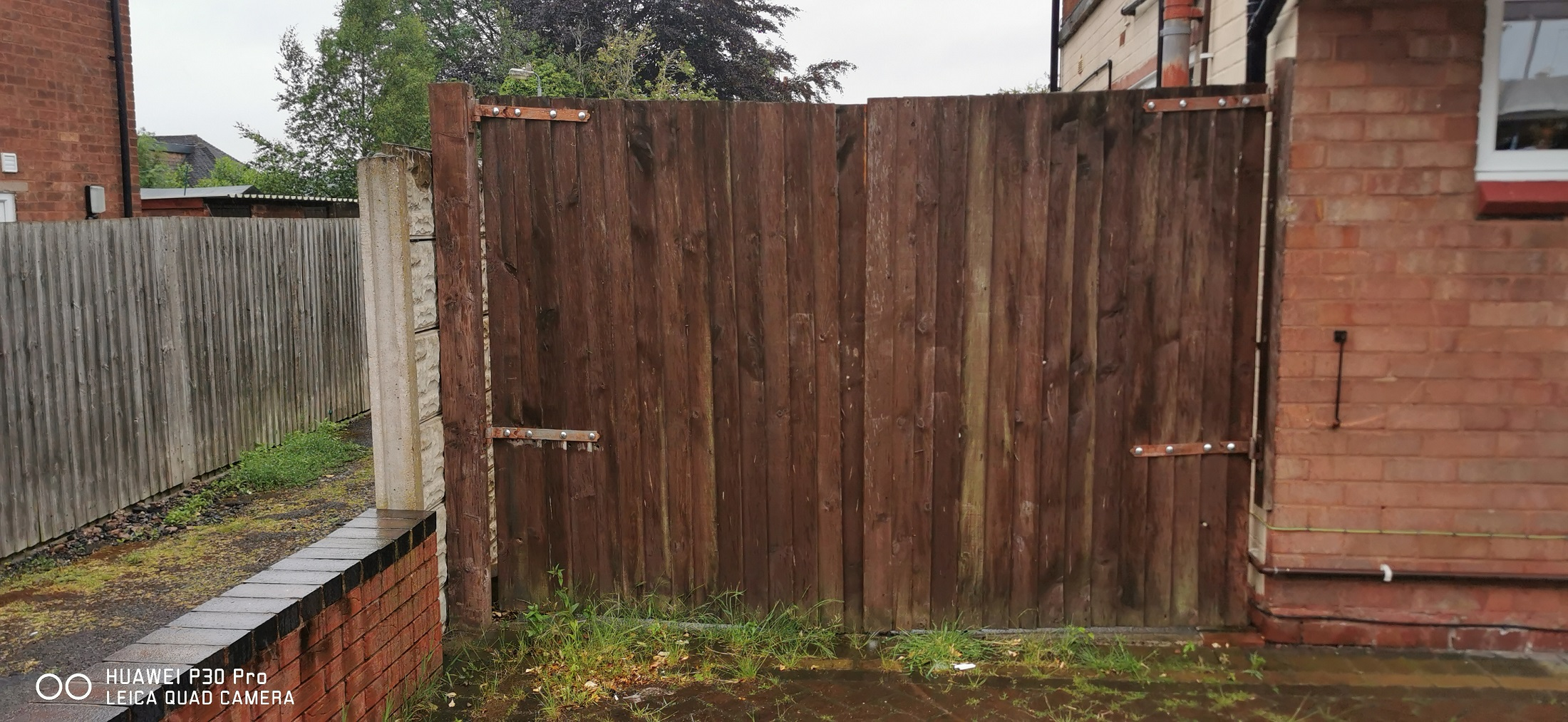 Old wooden gates in need of replacement